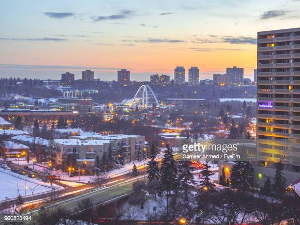 high angle view of illuminated buildings against sky during sunset - edmonton stock pictures, royalty-free photos & images