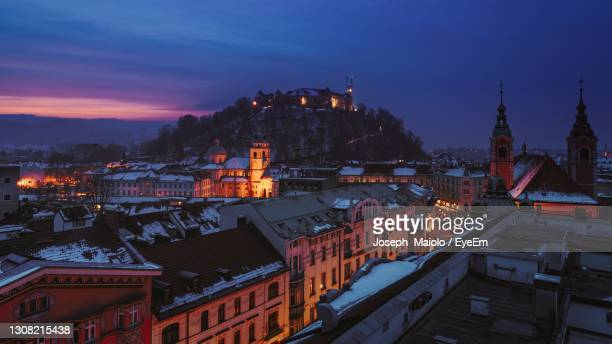 high angle view of illuminated buildings against sky during winter - リュブリャナ ストックフォトと画像