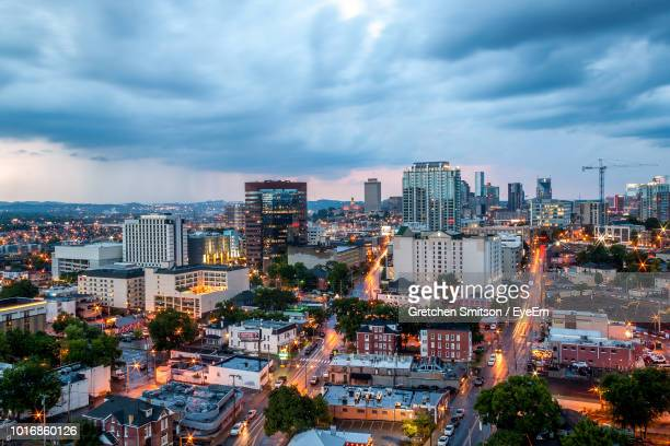 high angle view of illuminated buildings against sky - nashville stock pictures, royalty-free photos & images