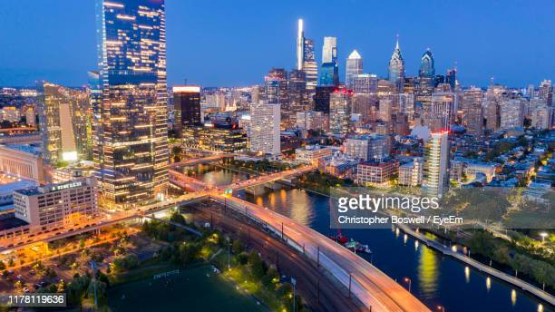 high angle view of illuminated buildings against sky - philadelphia skyline stock pictures, royalty-free photos & images
