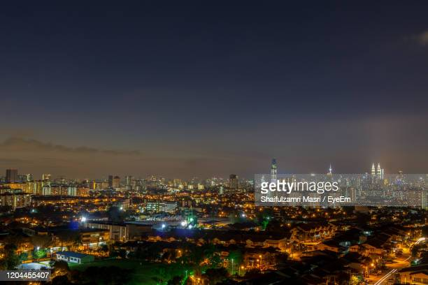 high angle view of illuminated buildings against sky - shaifulzamri photos et images de collection