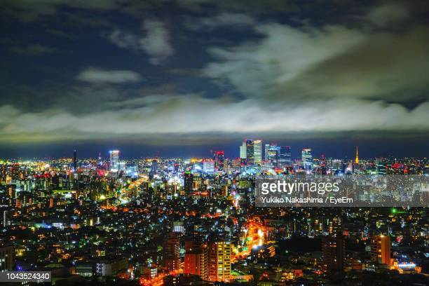 high angle view of illuminated buildings at night - 名古屋 ストックフォトと画像