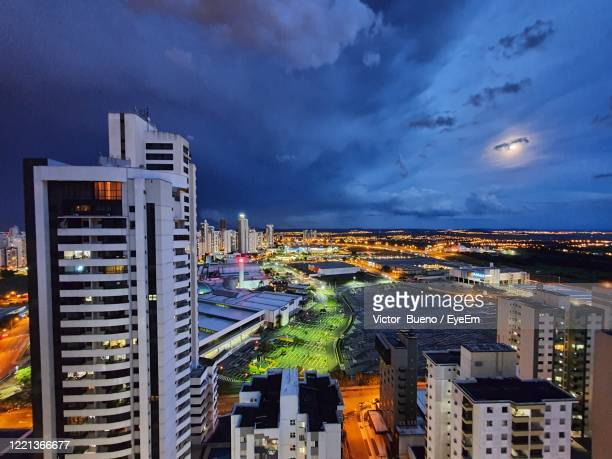 high angle view of illuminated buildings at night - goiania imagens e fotografias de stock