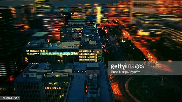 high angle view of illuminated buildings at night - constantia stock pictures, royalty-free photos & images