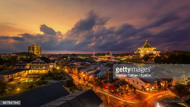 high angle view of illuminated buildings at sunset - sarawak state stock pictures, royalty-free photos & images