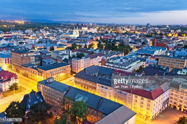 high angle view of illuminated buildings in city against sky - ostrava stock pictures, royalty-free photos & images