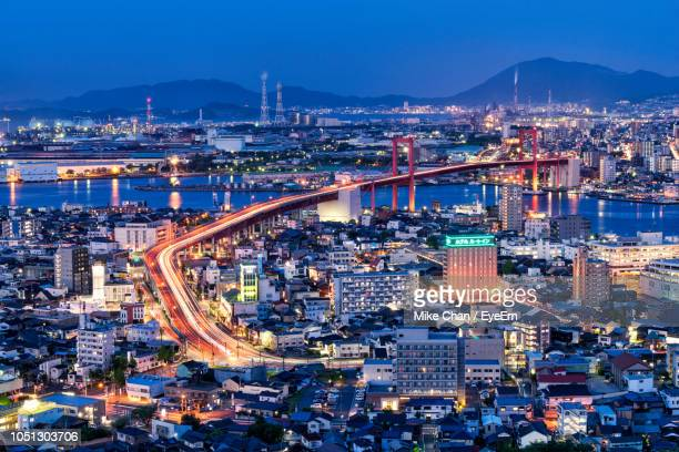 high angle view of illuminated buildings in city at night - 北九州市 ストックフォトと画像