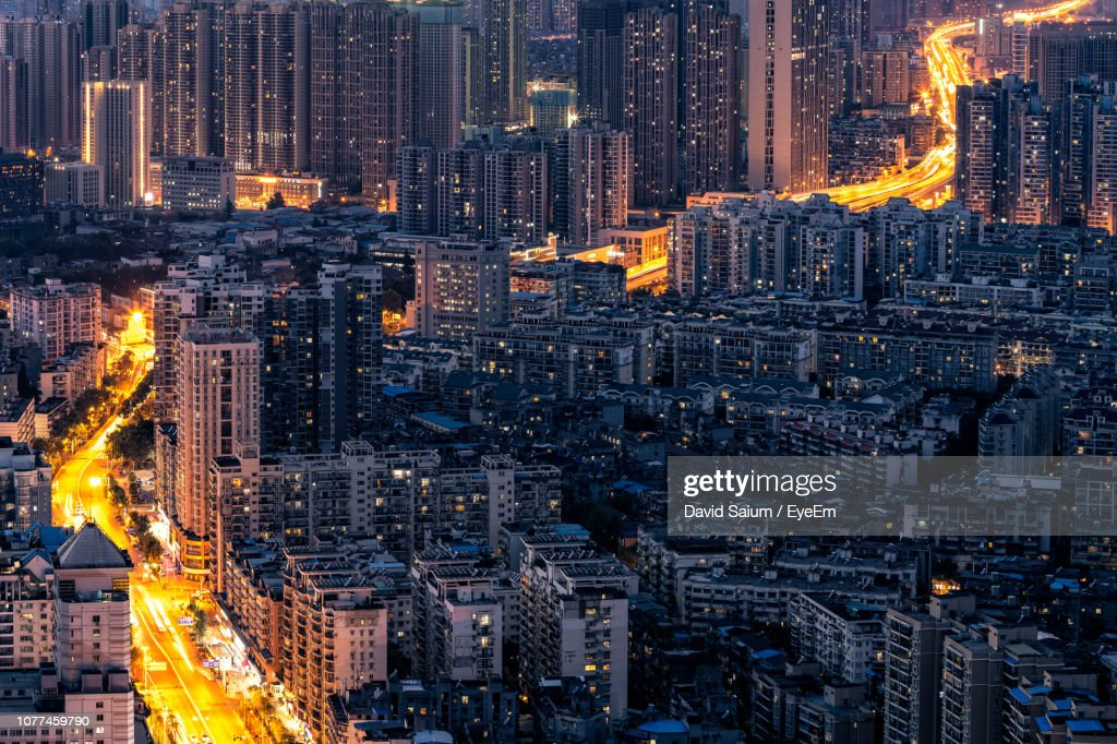 High Angle View Of Illuminated Buildings In City At Night : Stock Photo