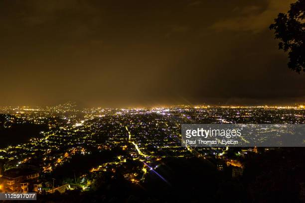 high angle view of illuminated buildings in city at night - kingston jamaica stock pictures, royalty-free photos & images
