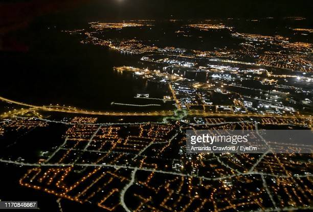 high angle view of illuminated buildings in city at night - night stock pictures, royalty-free photos & images