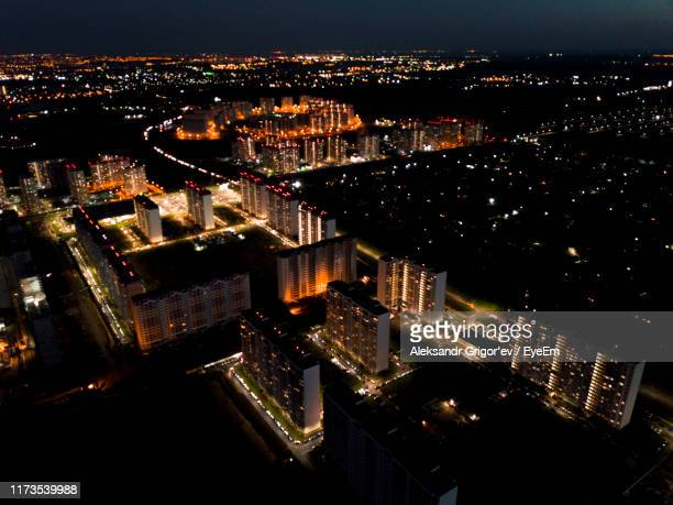 high angle view of illuminated buildings in city at night - rostov on don stock pictures, royalty-free photos & images