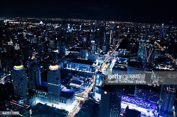 high angle view of illuminated buildings in city at night - hamilton new zealand stock pictures, royalty-free photos & images