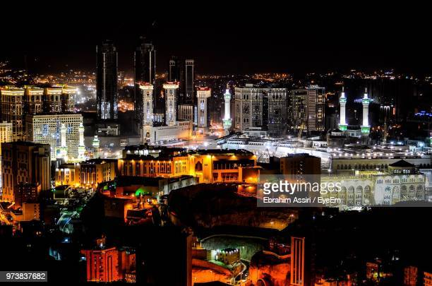 high angle view of illuminated buildings in city at night - mecca stock pictures, royalty-free photos & images