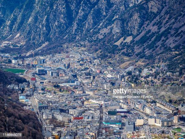 high angle view of illuminated buildings in city - andorra la vella stock pictures, royalty-free photos & images