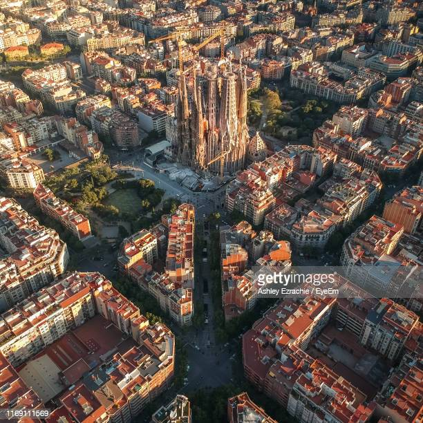 high angle view of illuminated buildings in city - barcelona spanien stock-fotos und bilder