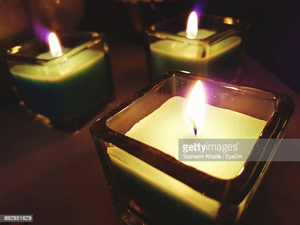 high angle view of illuminated candles on table - north lincolnshire stock pictures, royalty-free photos & images
