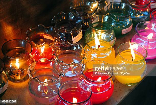 High Angle View Of Illuminated Candles