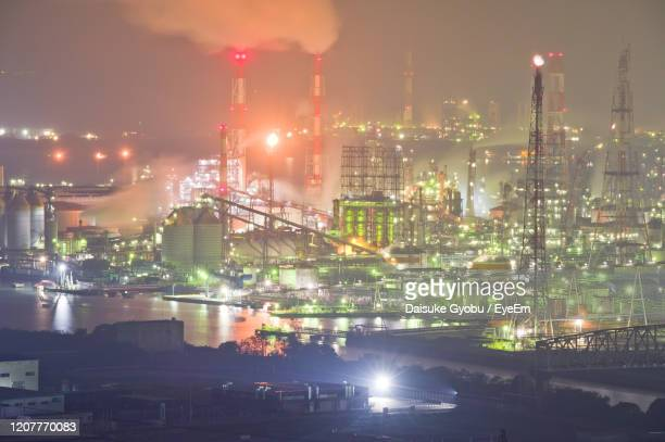 high angle view of illuminated chemical plants against sky at night - 工場地帯 ストックフォトと画像