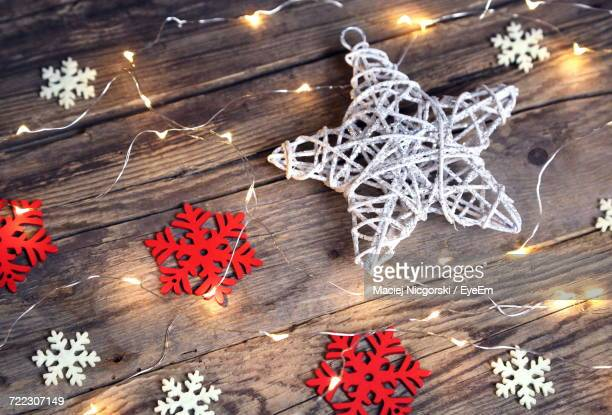 High Angle View Of Illuminated Christmas Decorations On Wooden Table