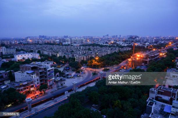 high angle view of illuminated city against blue sky - uttar pradesh stock pictures, royalty-free photos & images