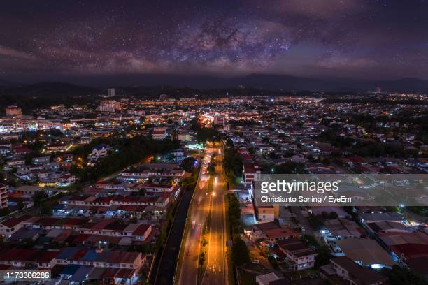 high angle view of illuminated city against sky at night - blackout stock pictures, royalty-free photos & images