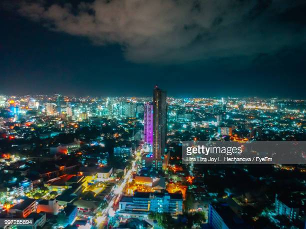 high angle view of illuminated city against sky at night - cebu province stock pictures, royalty-free photos & images