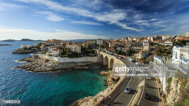 high angle view of illuminated city against sky - marseille photos et images de collection