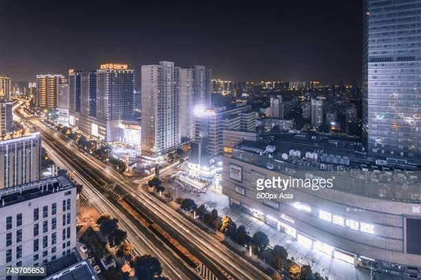 high angle view of illuminated city at night, changzhou, jiangsu, china - changzhou stock pictures, royalty-free photos & images