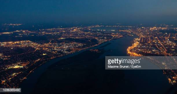 high angle view of illuminated city at night - montréal stock pictures, royalty-free photos & images