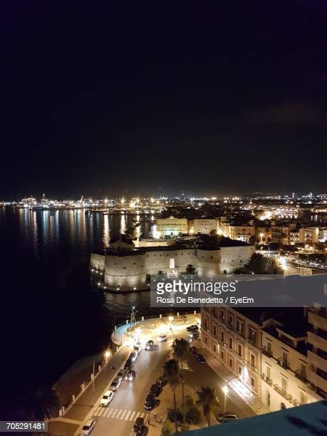 high angle view of illuminated city at night - benedetto photos et images de collection