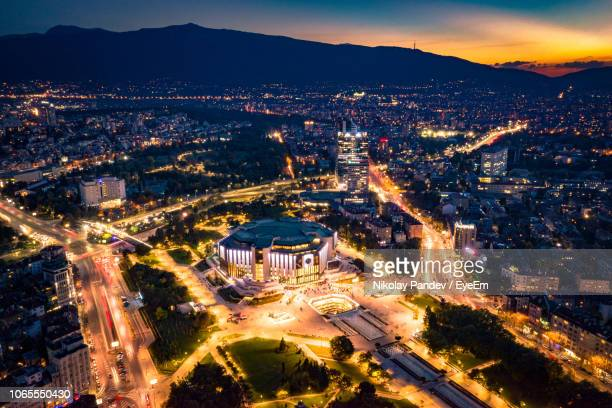 high angle view of illuminated city buildings at night - sofia stock pictures, royalty-free photos & images