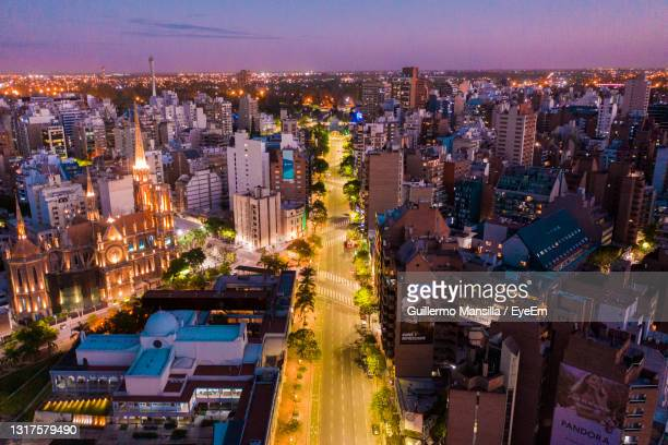 high angle view of illuminated city buildings at night - cordoba argentina stock pictures, royalty-free photos & images