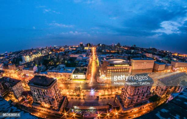high angle view of illuminated city buildings at night - kiev stock pictures, royalty-free photos & images