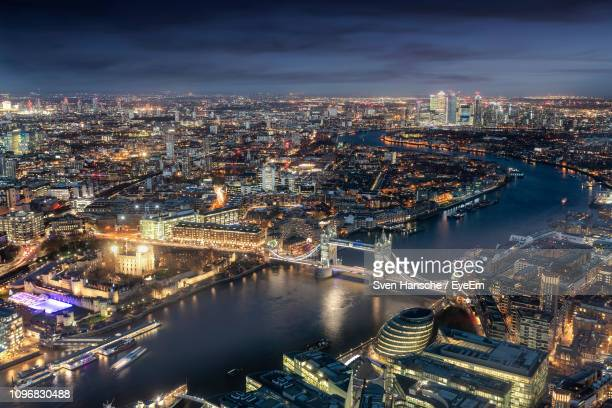 high angle view of illuminated city buildings by river - london bridge england stock pictures, royalty-free photos & images