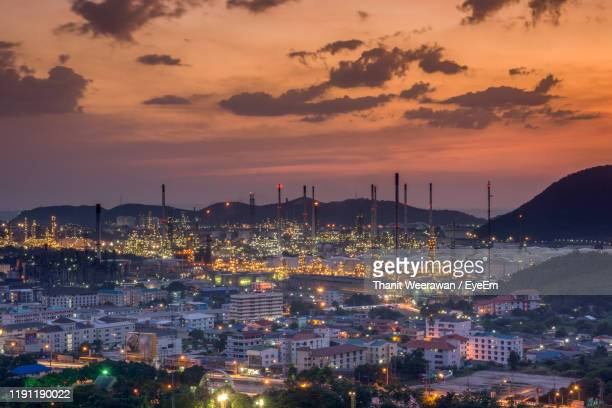 high angle view of illuminated city buildings during sunset - chonburi province stock pictures, royalty-free photos & images