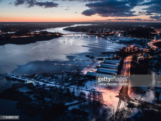high angle view of illuminated city during sunset - トゥルク ストックフォトと画像