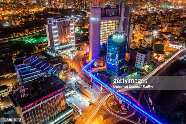 high angle view of illuminated city street and buildings at night - beirut stock pictures, royalty-free photos & images