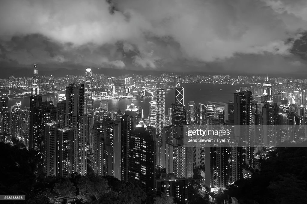 High Angle View Of Illuminated Cityscape Against Cloudy Sky : Stock-Foto