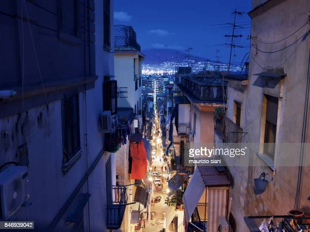 high angle view of illuminated cityscape against sky at night - napoli stock-fotos und bilder
