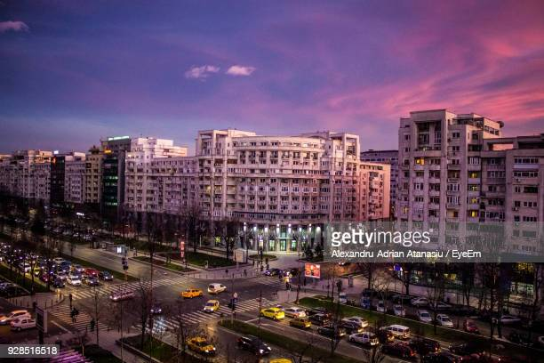 high angle view of illuminated cityscape against sky at night - bucharest stock pictures, royalty-free photos & images