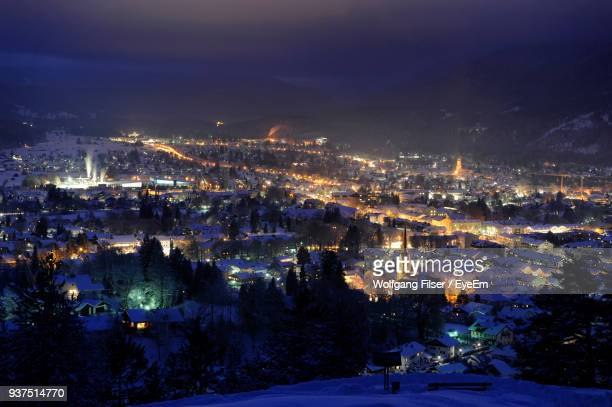 high angle view of illuminated cityscape against sky at night - garmisch partenkirchen stock pictures, royalty-free photos & images