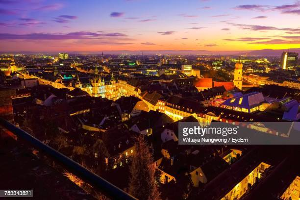 high angle view of illuminated cityscape against sky at sunset - graz stock photos and pictures