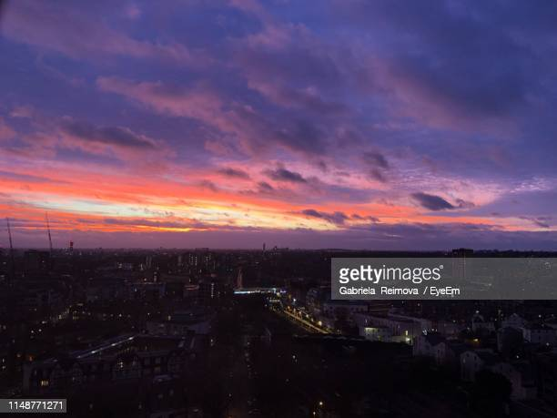 high angle view of illuminated cityscape against sky during sunset - gabriela stock pictures, royalty-free photos & images