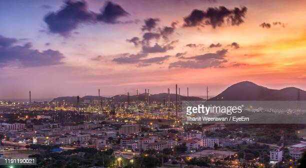 high angle view of illuminated cityscape against sky during sunset - chonburi province stock pictures, royalty-free photos & images