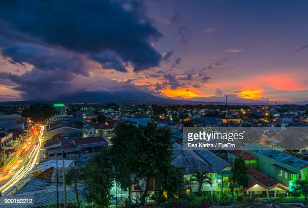 high angle view of illuminated cityscape against sky during sunset - bogor stock pictures, royalty-free photos & images