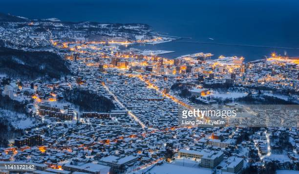 high angle view of illuminated cityscape against sky - townscape stock pictures, royalty-free photos & images