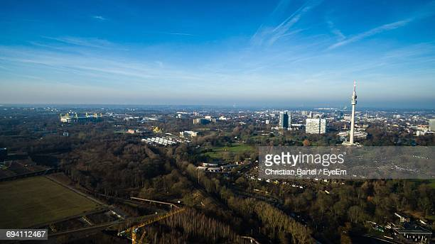 high angle view of illuminated cityscape against sky - dortmund city stock pictures, royalty-free photos & images