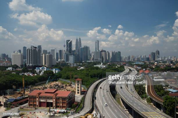high angle view of illuminated cityscape against sky - shaifulzamri eyeem stock pictures, royalty-free photos & images