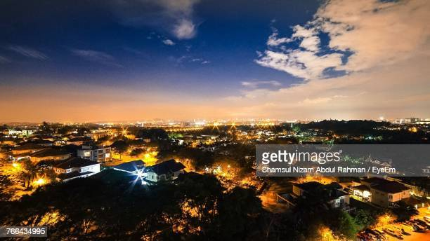 high angle view of illuminated cityscape against sky - shah alam stock photos and pictures
