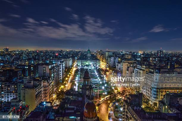 High Angle View Of Illuminated Cityscape At Dusk